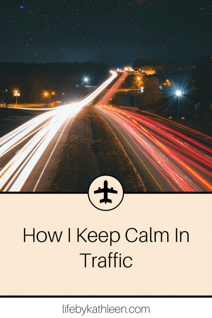 long exposure of cars on a road at night. text overlay how I keep calm in traffic