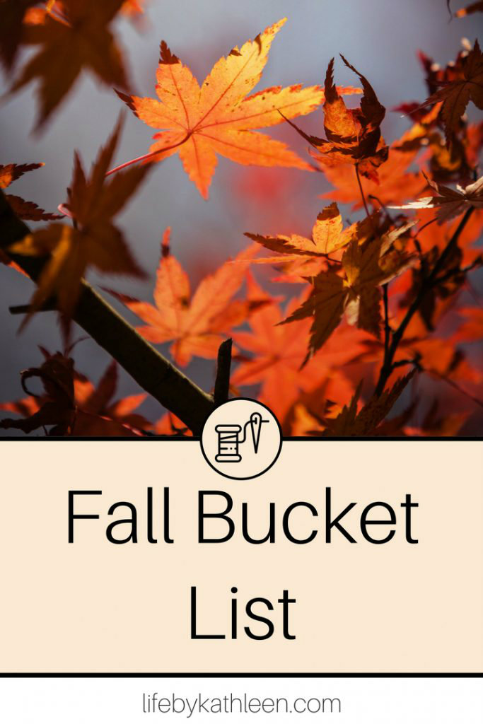 fall leaves on a tree text overlay fall bucket list
