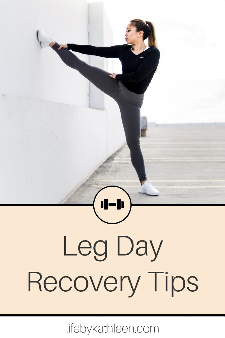 girl stretching leg on the wall text overlay: Leg Day Recovery Tips
