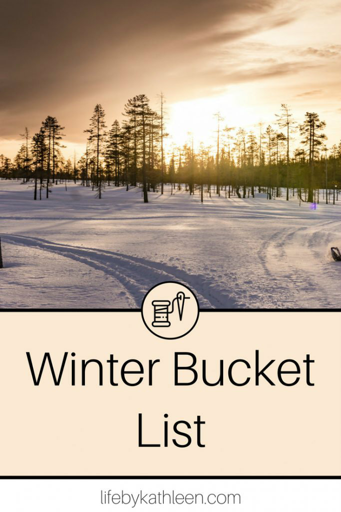sunset over snow and trees text overlay winter bucket list